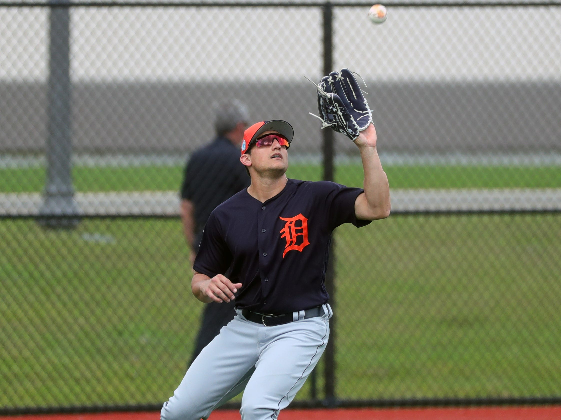 Tigers outfielder Mikie Mahtook fields a fly ball during spring training Wednesday, Feb. 20, 2019, at Joker Marchant Stadium in Lakeland, Fla.