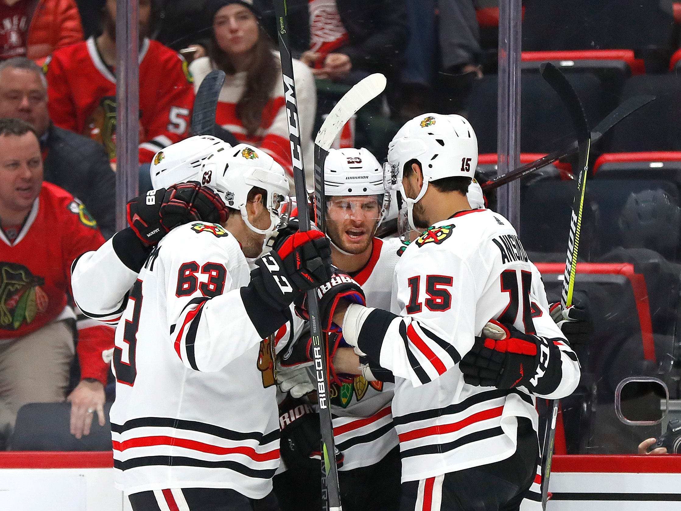 Chicago Blackhawks left wing Brandon Saad, second from left, celebrates his goal against the Detroit Red Wings in the first period of an NHL hockey game Wednesday, Feb. 20, 2019, in Detroit.