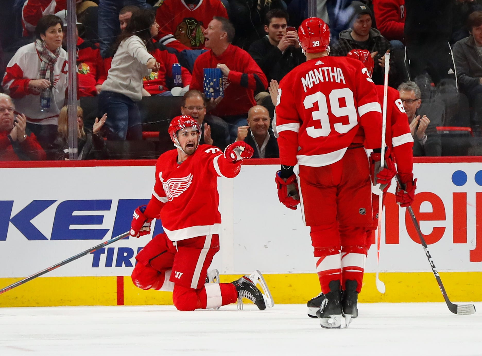 Detroit Red Wings center Dylan Larkin, left, celebrates his goal against the Chicago Blackhawks in the third period of an NHL hockey game Wednesday, Feb. 20, 2019, in Detroit.