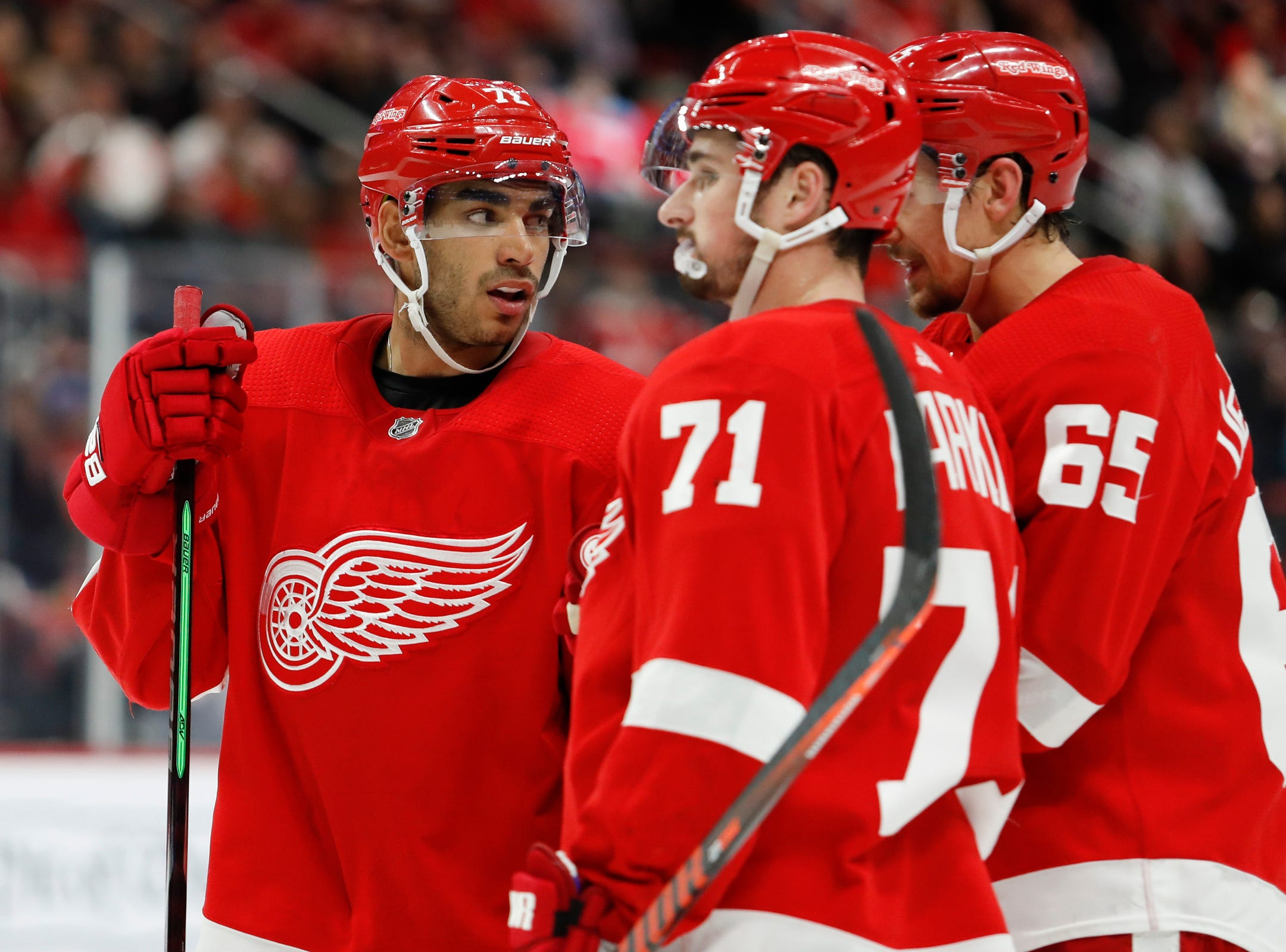Red Wings center Andreas Athanasiou, left, chats with center Dylan Larkin (71) and defenseman Danny DeKeyser during overtime of the Wings' 5-4 loss on Wednesday, Feb. 20, 2019, at Little Caesars Arena.