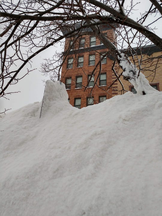 Piles of now has been pushed and covers a street sign on Thursday, Feb. 21, 2019 in Sault Ste. Marie.
