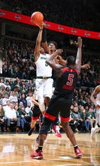 MSU guard Cassius Winston draws a foul from Myles Johnson of the Rutgers Scarlet Knights in the first half at Breslin Center on February 20, 2019, in East Lansing.