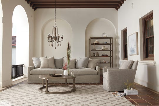 A neutral space may seem simple at first, but it can reveal clever ideas like a chandelier in a living area.