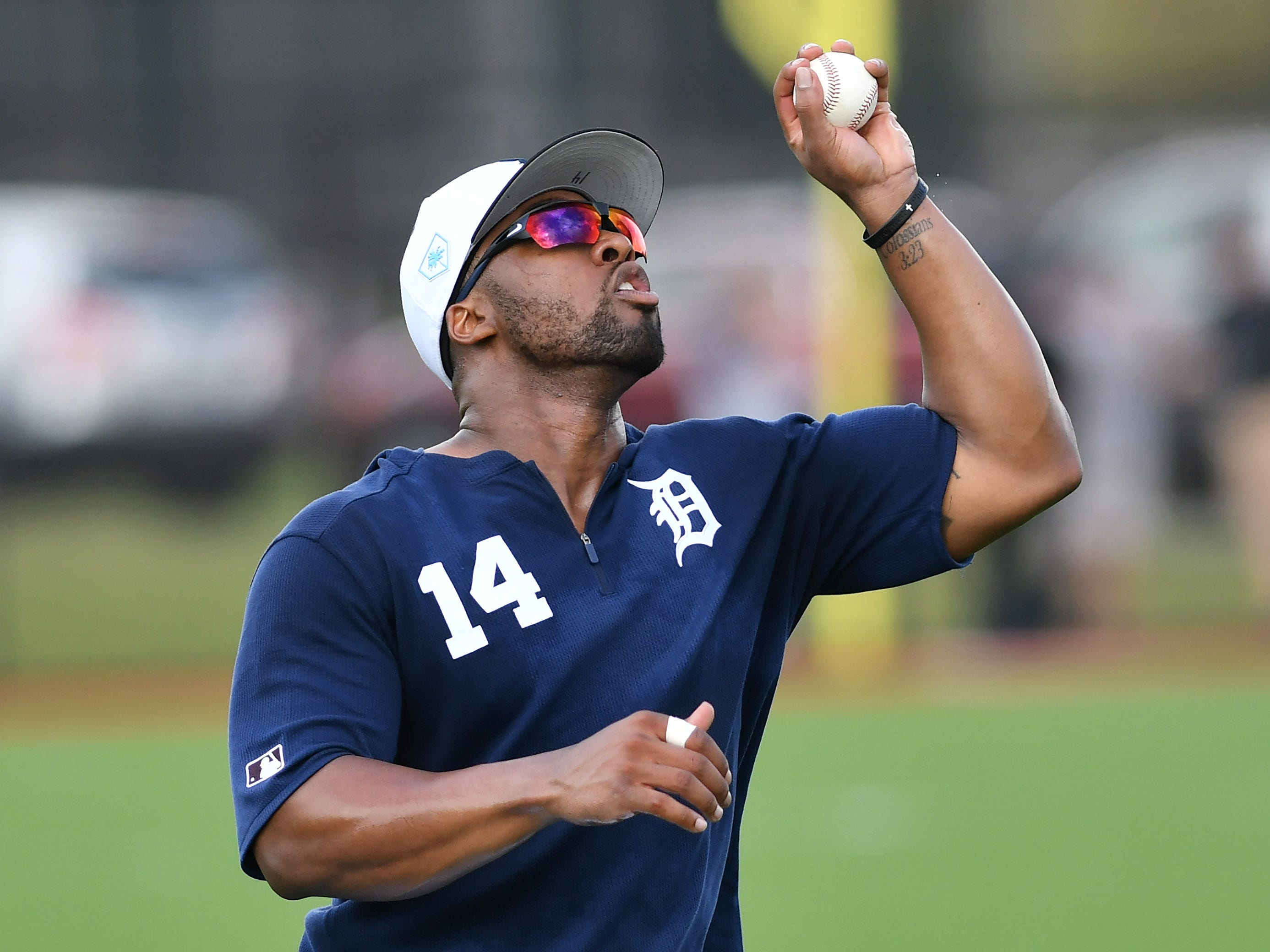 Tigers outfielder Christin Stewart catches a pop-up barehanded during drills.
