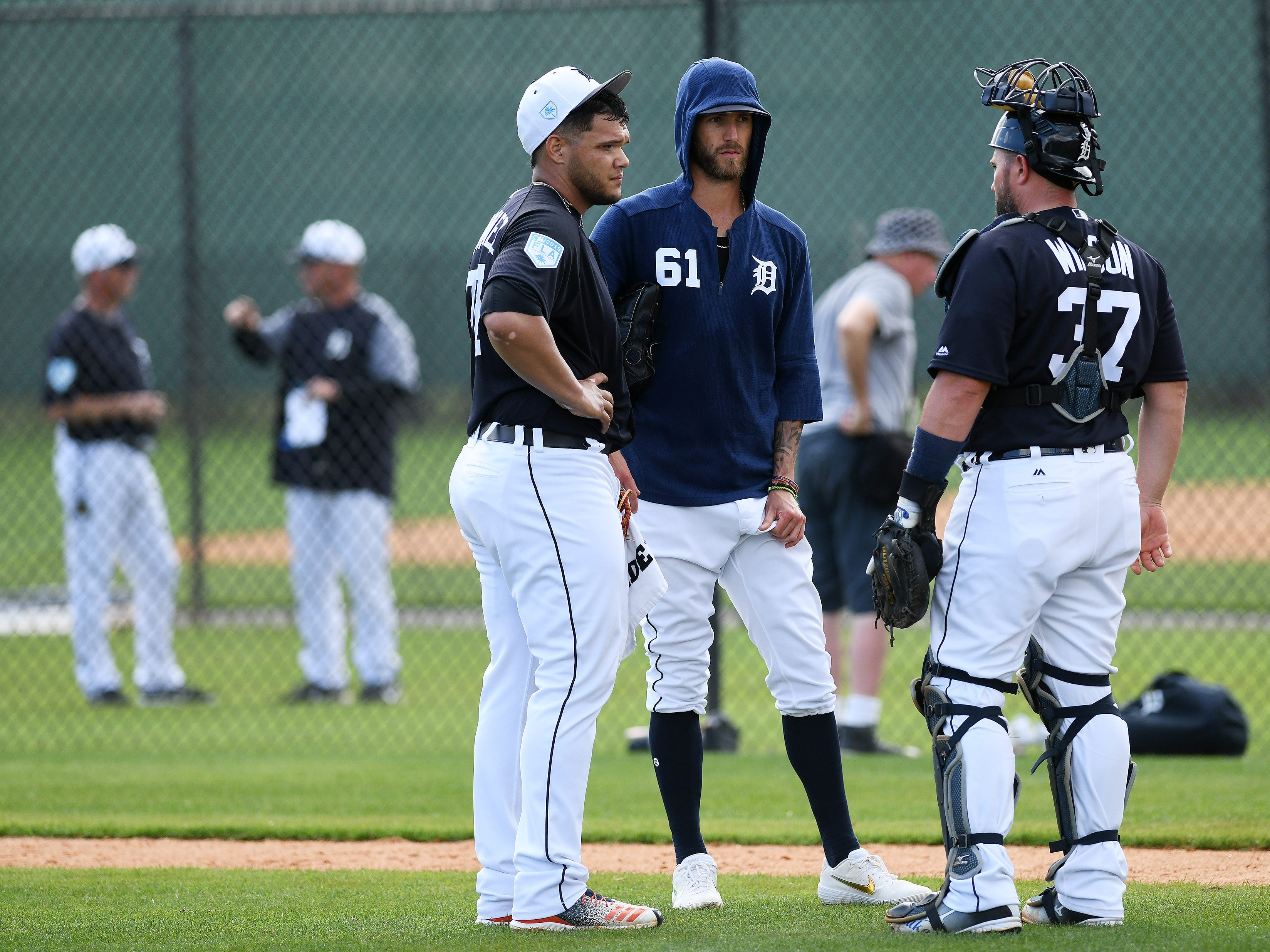 From left, Tigers pitcher Joe Jimenez talks with pitcher Shane Greene and catcher Bobby Wilson after Jimenez pitches live batting practice.