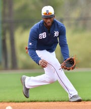 Niko Goodrum fields a grounder at the Tigers' workout at spring training on Thursday.