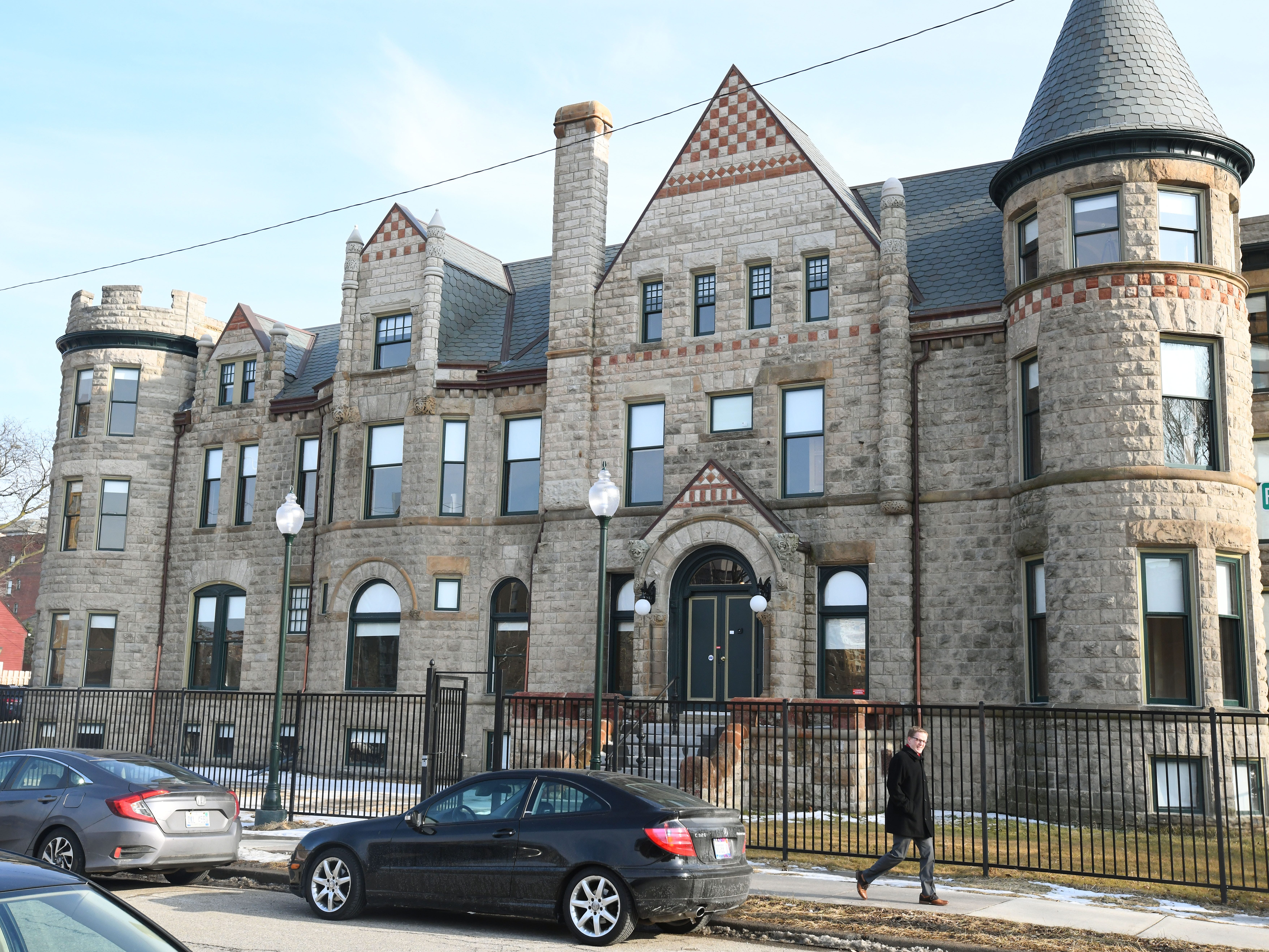 Guests tour historic Scott Mansion which has been renovated into market-rate rental apartments in the Cass Corridor  in Detroit, Michigan on February 21, 2019. The $6 million project leverages federal and state historic tax credits and as well as a mortgage from Capital Impact Partners.