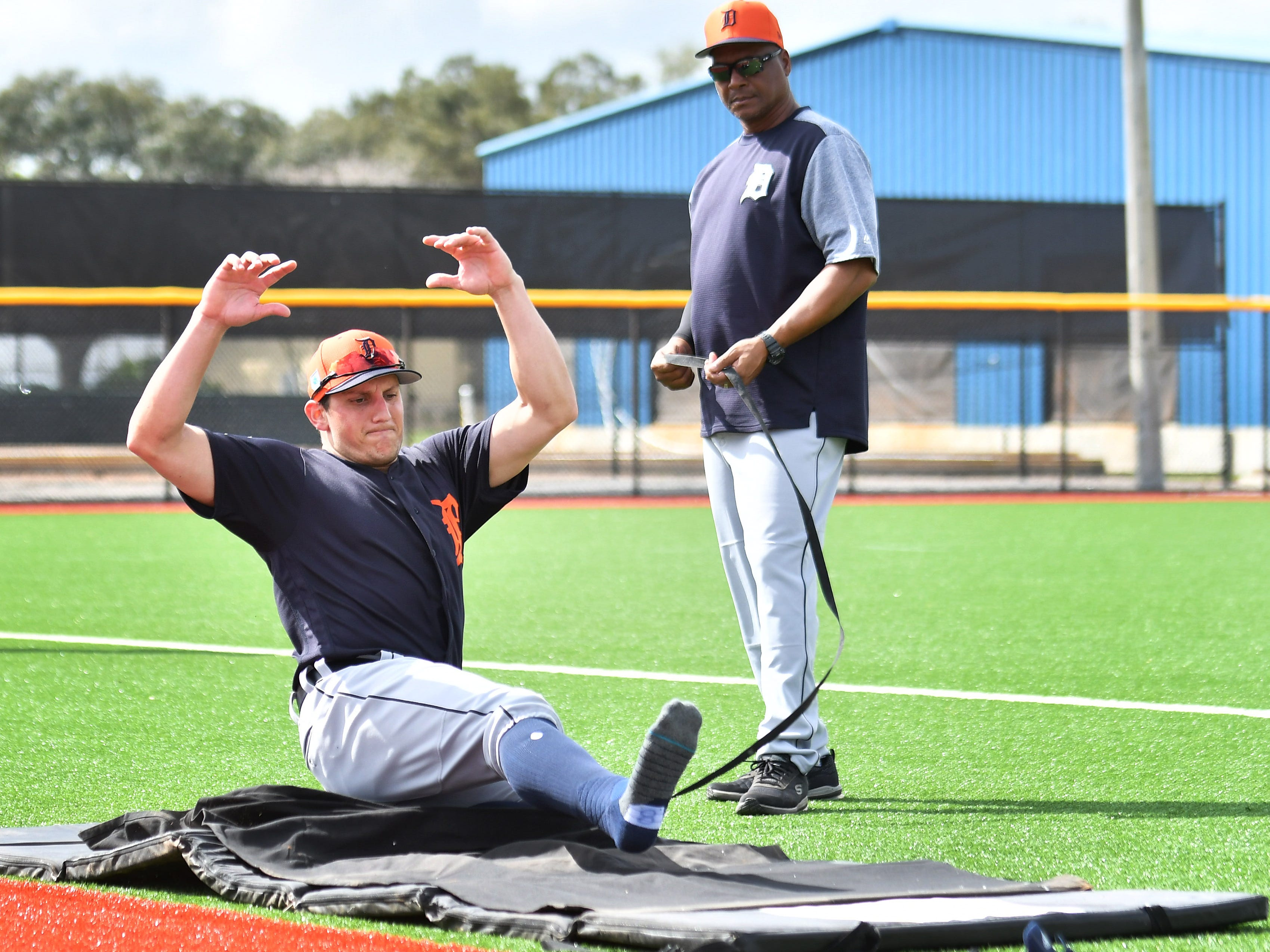 Tigers outfielder Mikie Mahtook practices sliding on a training mat.
