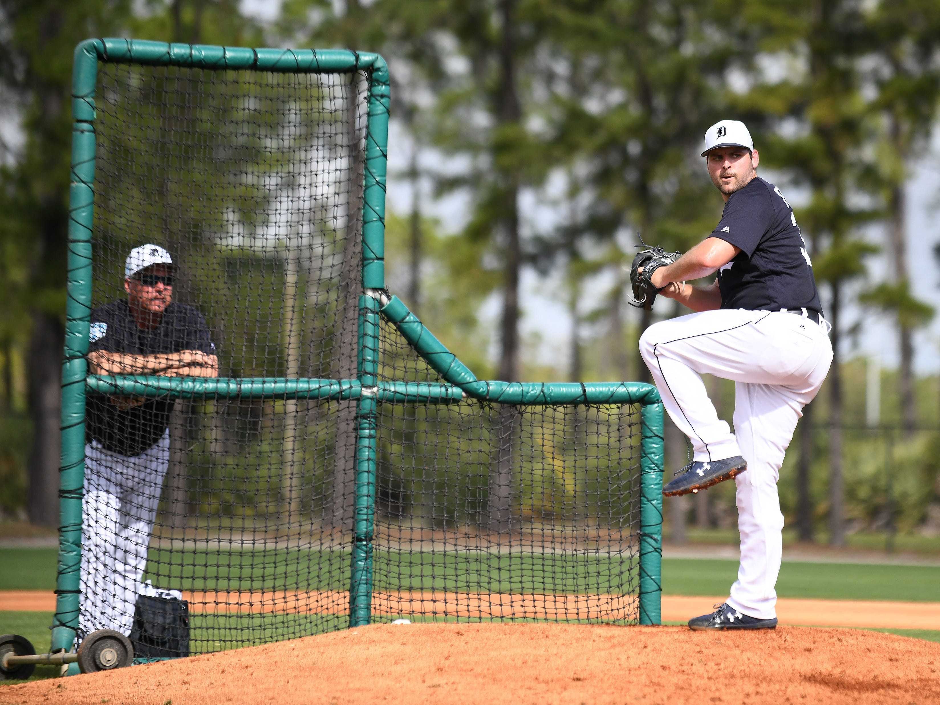 Tigers pitching coach Rick Anderson, left, watches pitcher Michael Fulmer throwing his first live batting session Thursday, Feb. 21, 2019, during the Tigers workout at spring training in Lakeland, Fla.