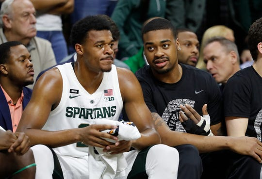 Michigan State forward Xavier Tillman (left) had 19 points and 10 rebounds in Wednesday night's victory over Rutgers, his first game since an injury to starter Nick Ward (right).