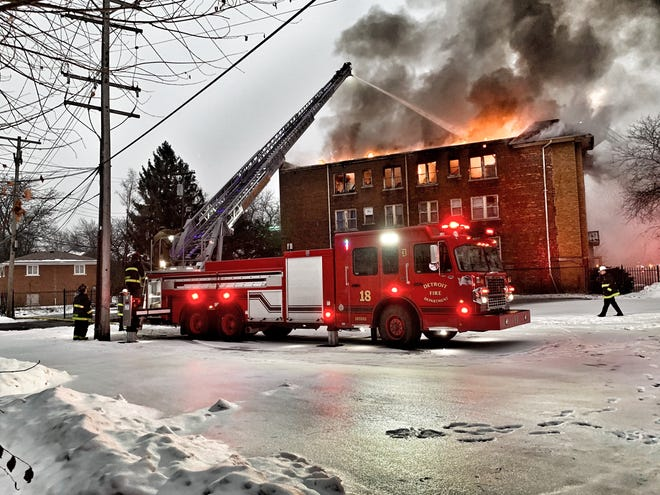 Detroit firefighters battle a blaze in a three-story  apartment building at Linwood and Oakman on Detroit's west side in below-freezing temperatures Wednesday, February 20, 2019.