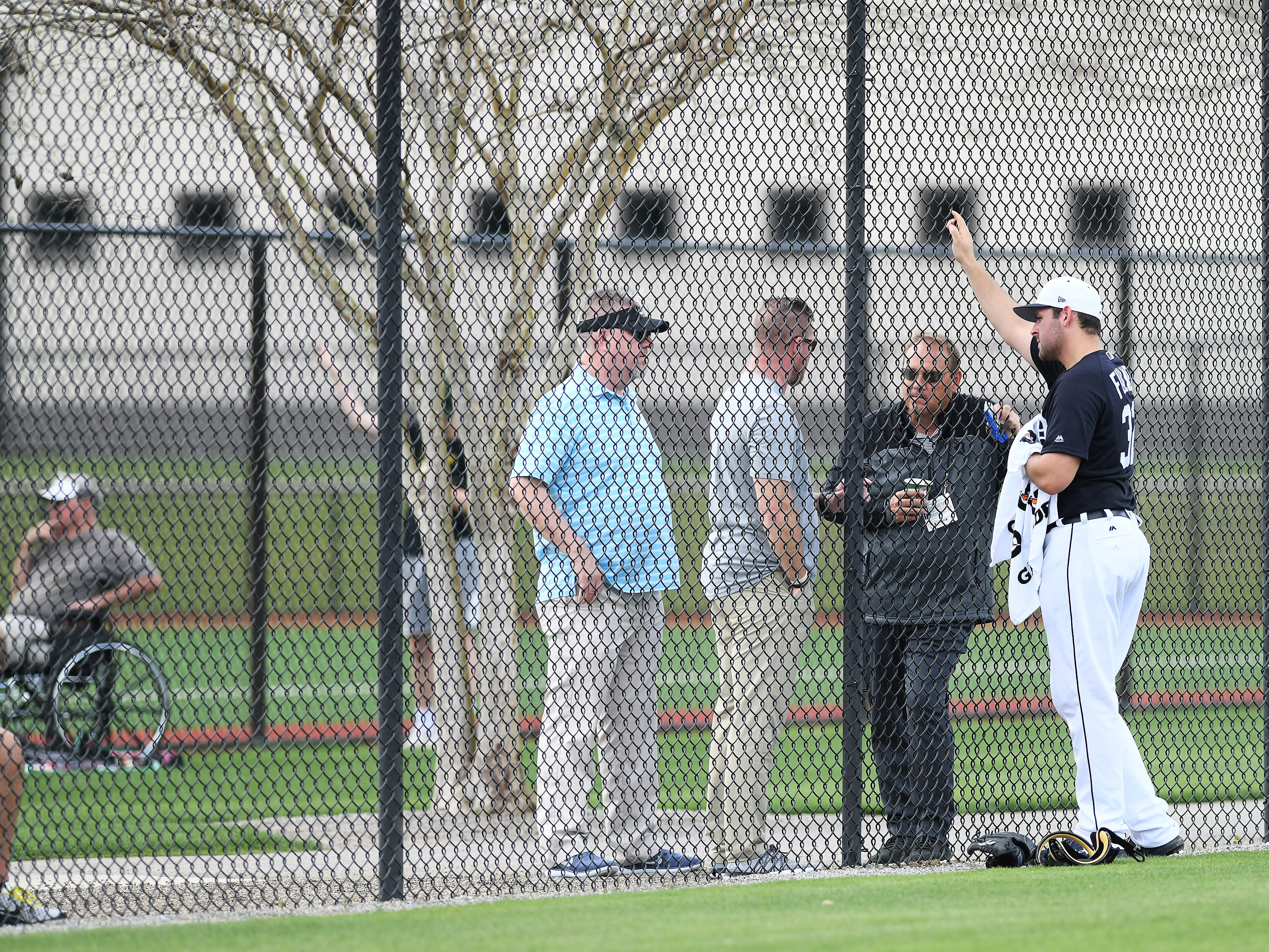 From right, After pitching live batting practice, Tigers pitcher Michael Fulmer talks with Tigers vice president, assistant general manager David Chadd.