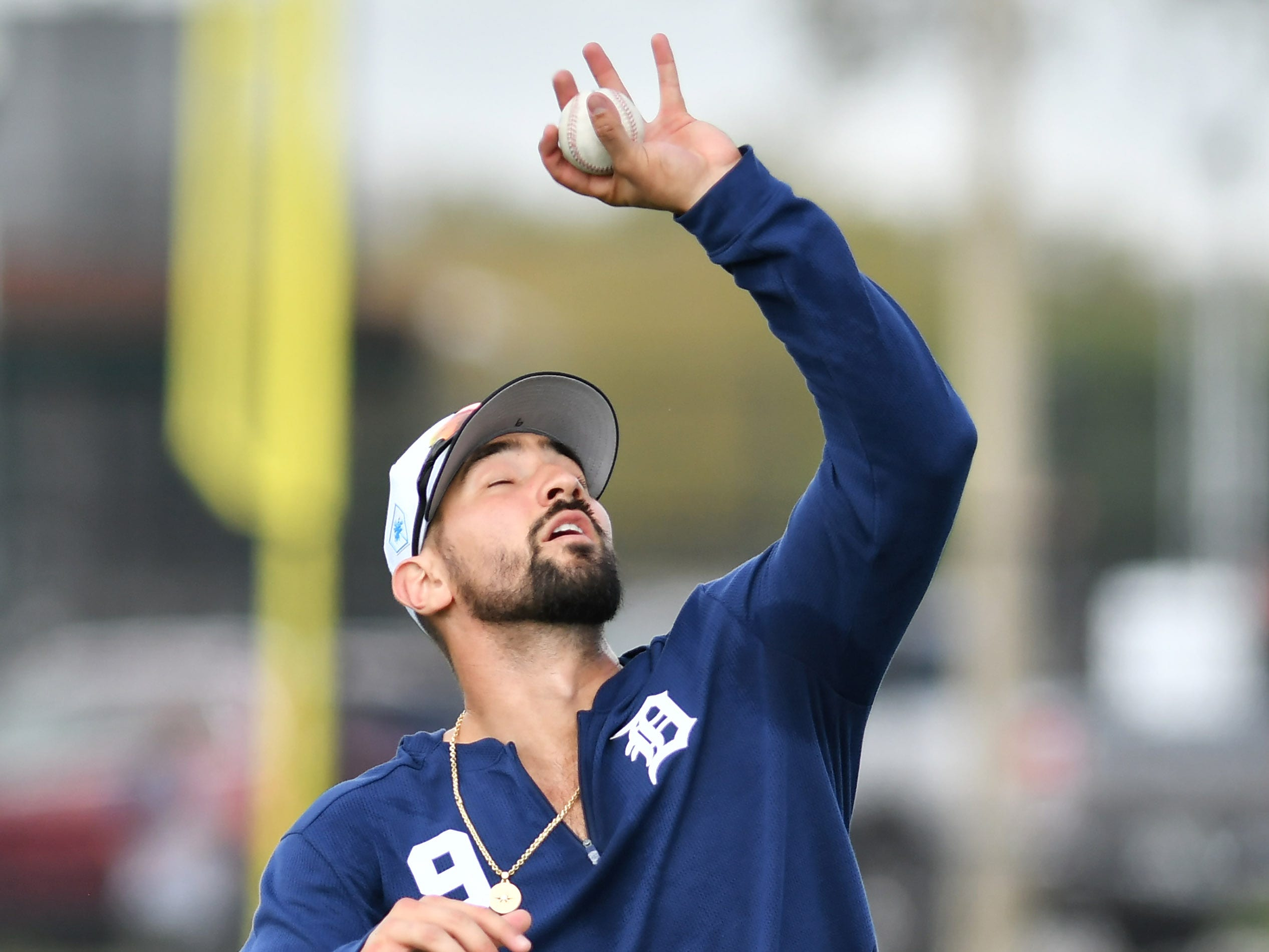 Tigers outfielder Nick Castellanos catches a pop-up barehanded during drills.