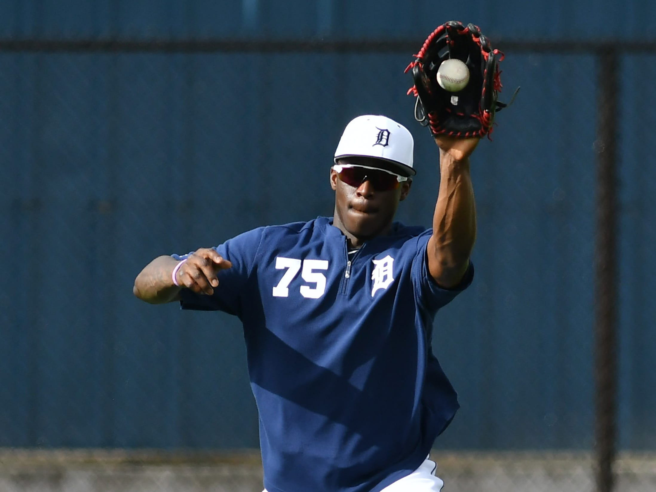 Tigers non-roster invitee Daz Cameron fields the ball on one hop during drills.