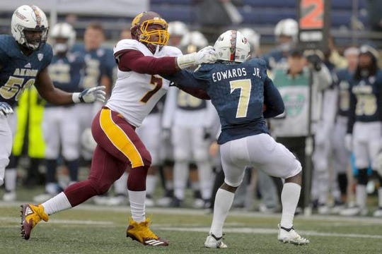Central Michigan defensive lineman Mike Danna, left, who was an all-MAC performer last season, thinks he can be starter for Michigan this coming fall.