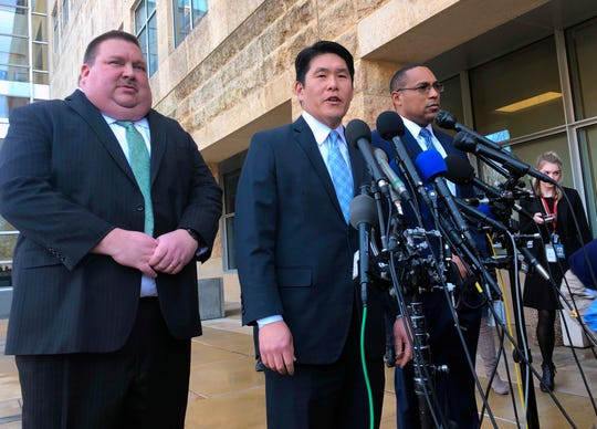 U.S. Attorney Robert Hur, center, of the District of Maryland, speaks as Art Walker, left, special agent from the Coast Guard investigative service, and Gordon Johnson, special agent in charge of the FBI's Baltimore office, listen during a news conference about Coast Guard Lt. Christopher Paul Hasson, Thursday, Feb. 21, 2019, outside the federal courthouse in Greenbelt, Md.