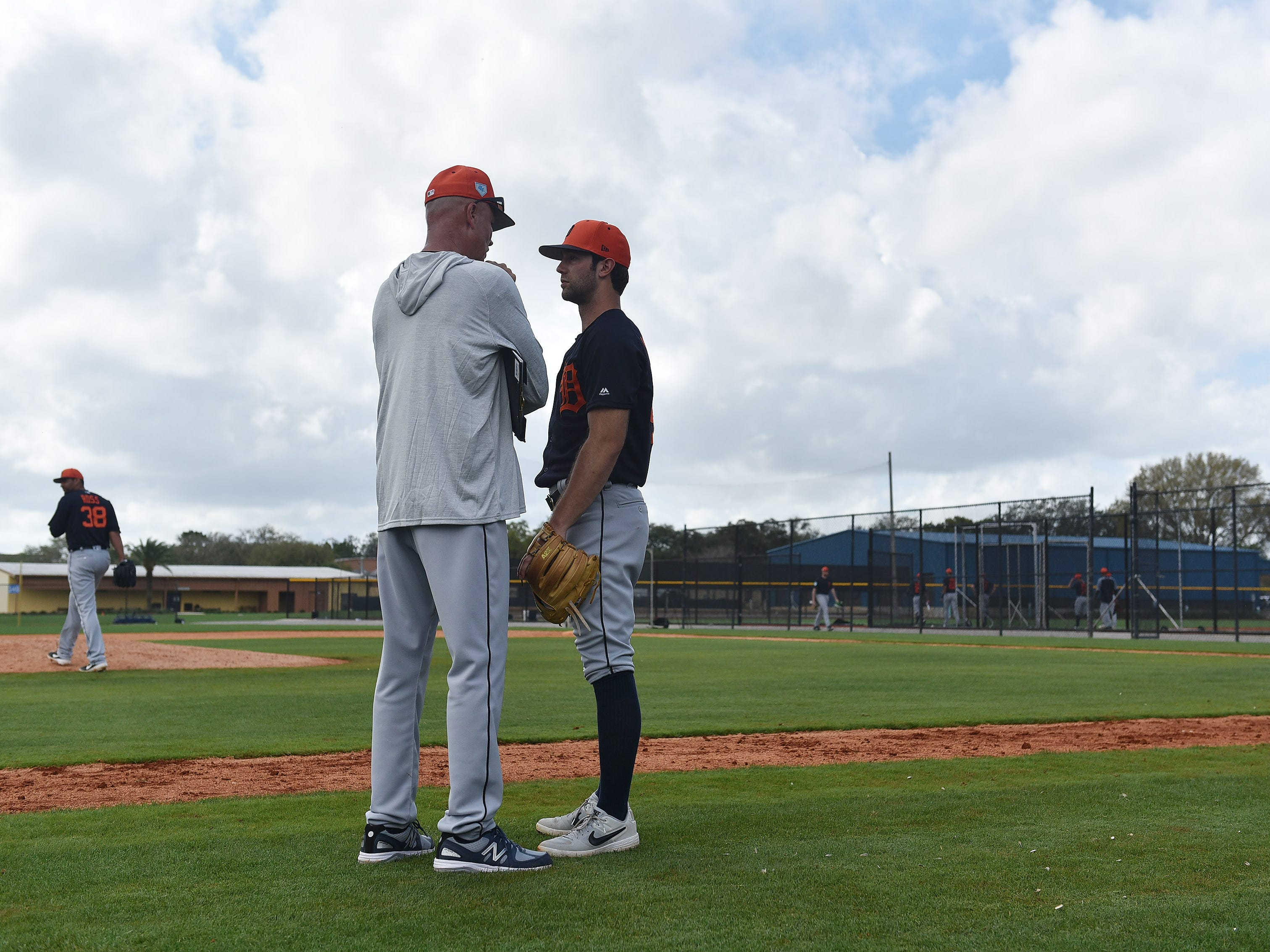 Tigers bench coach Steve Liddle talks with pitcher Daniel Norris.