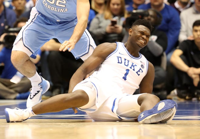 Zion Williamson of the Duke Blue Devils reacts after falling as his shoe breaks in the first half of the game against the North Carolina Tar Heels.
