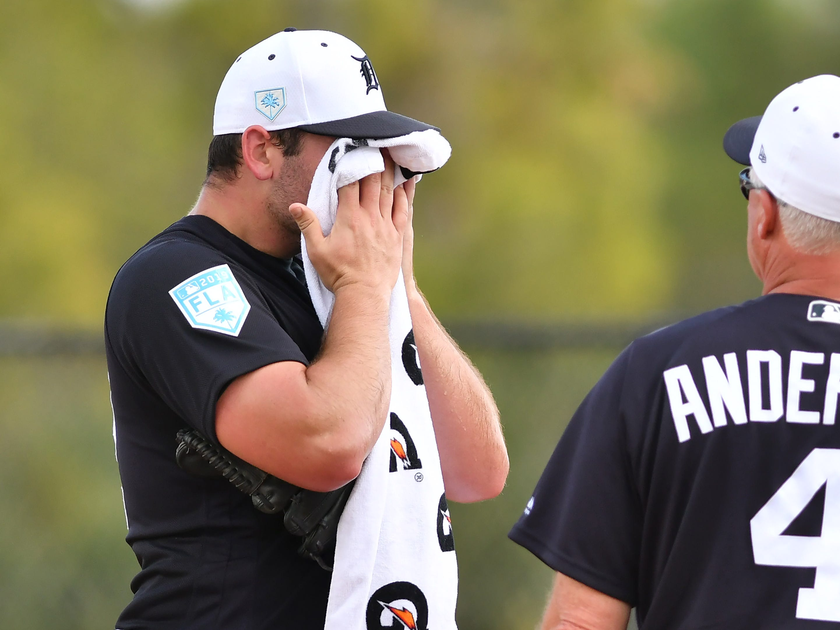 Tigers pitcher Michael Fulmer wipes off the sweat after his first live batting practice.