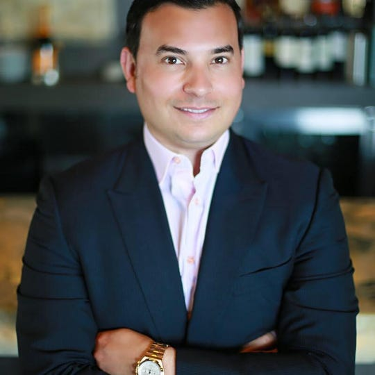 Aaron F. Belen, owner of Bistro 82.