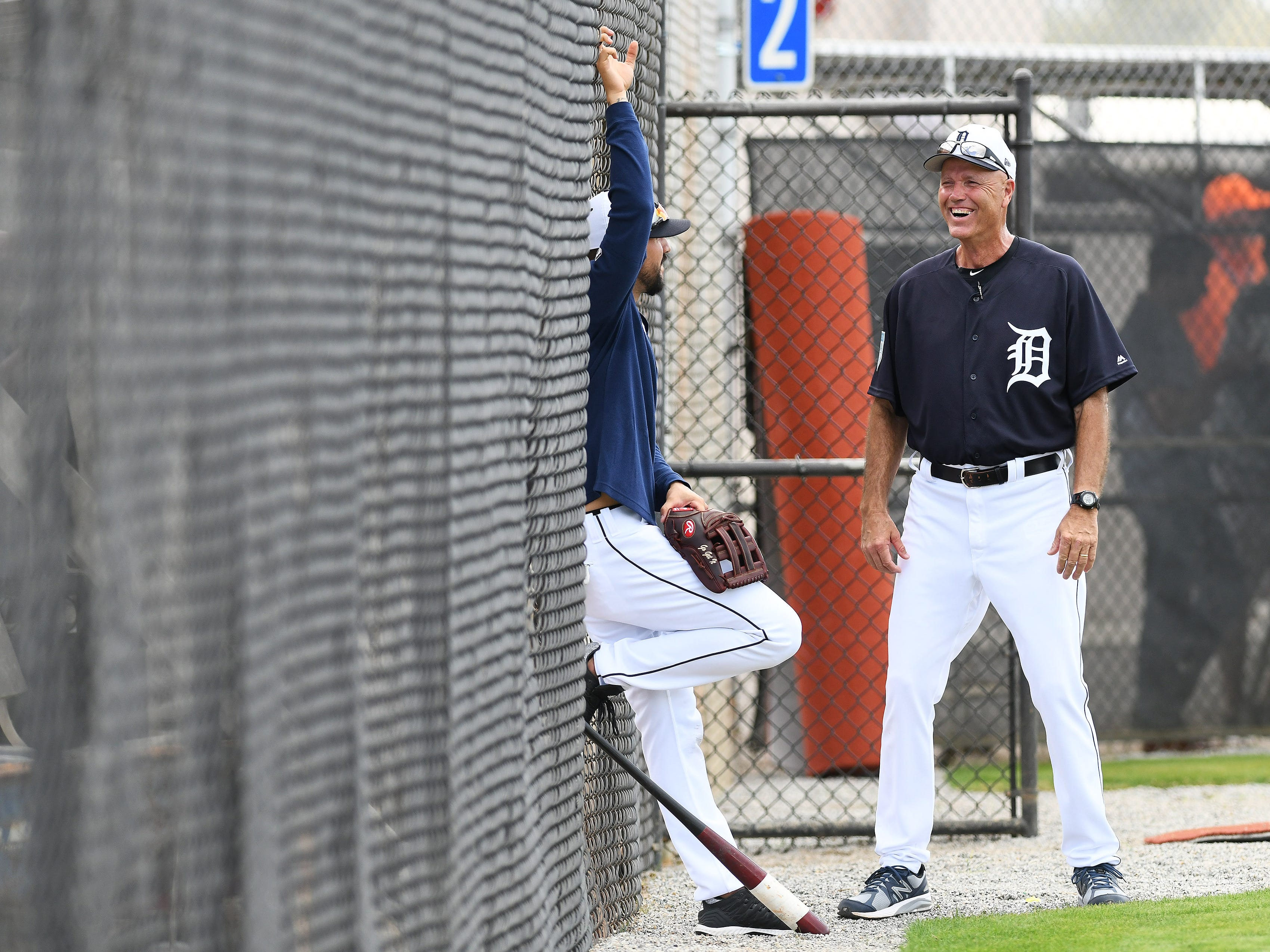 Tigers bench coach Steve Liddle talks with Nick Castellanos during batting practice.