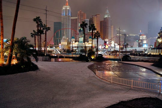 A dusting of snow covers an area along the Las Vegas Strip, Thursday, Feb. 21, 2019, in Las Vegas.