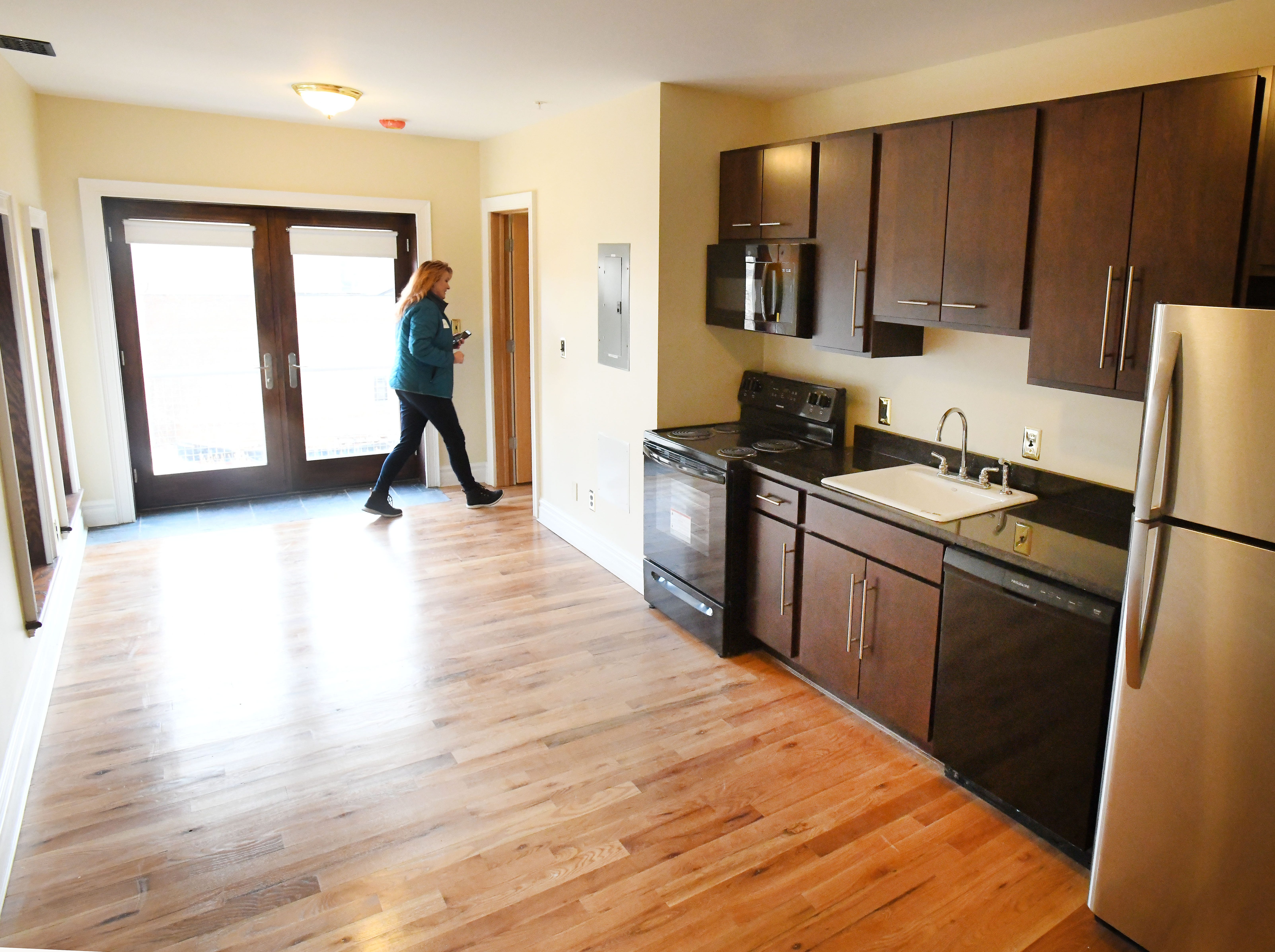 Guests tour a 3rd floor apartment at the historic Scott Mansion.