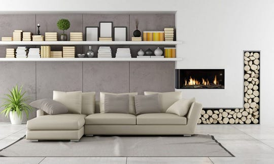 AT HOME for release FEBRUARY 2019 HOME TOUCH Caption 2: Zero-clearance model fireplaces installed at eye level in the wall create a modern minimalistic look. Flare fireplaces deliver on clean design with glass that protrudes out on the corners to provide more viewing angles and flair.