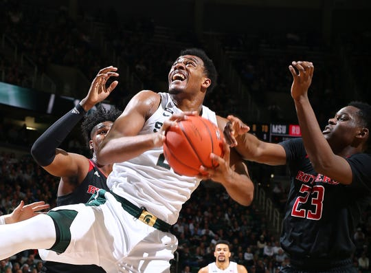 Xavier Tillman of the Michigan State Spartans shoots the ball while defended by Montez Mathis of the Rutgers Scarlet Knights in the first half.