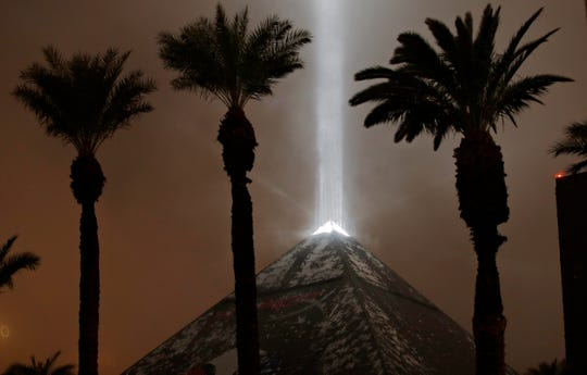 Snow falls on the Luxor hotel and casino Wednesday, Feb. 20, 2019, in Las Vegas.