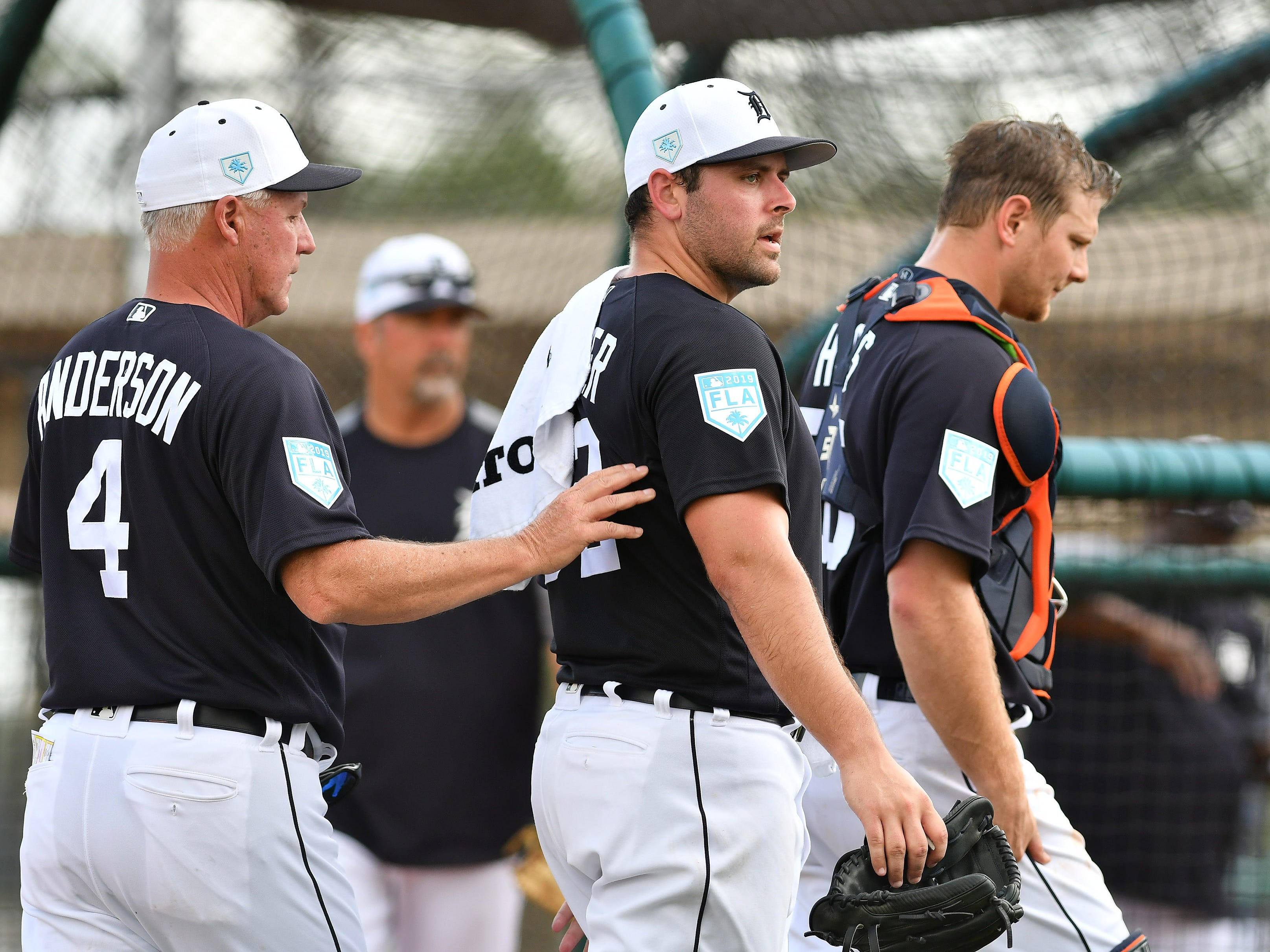 From left, Tigers pitching coach Rick Anderson, pitcher Michael Fulmer and catcher John Hicks walk off the field after Fulmer's live batting session.