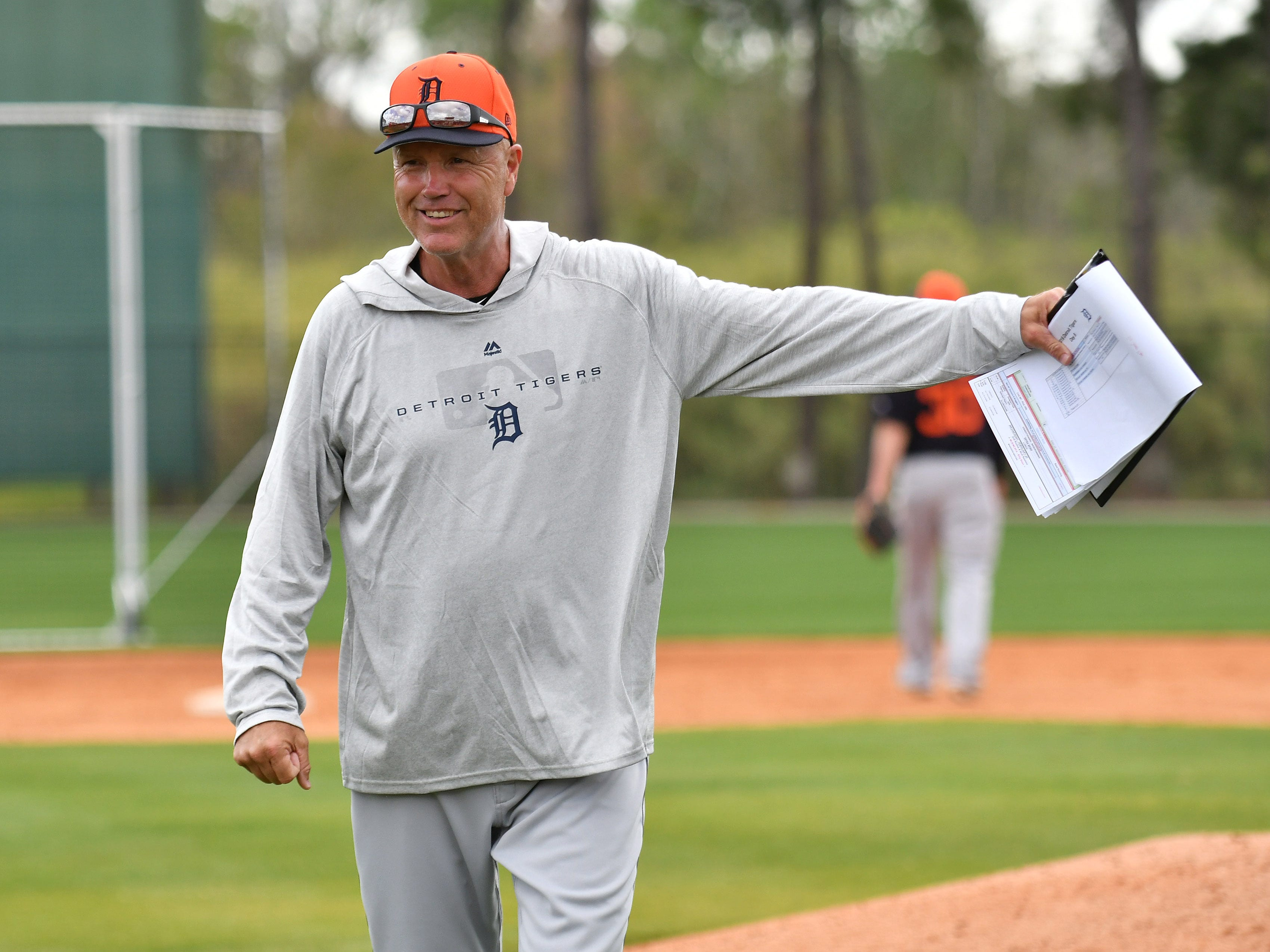 Tigers bench coach Steve Liddle gives instructions during infield drills.