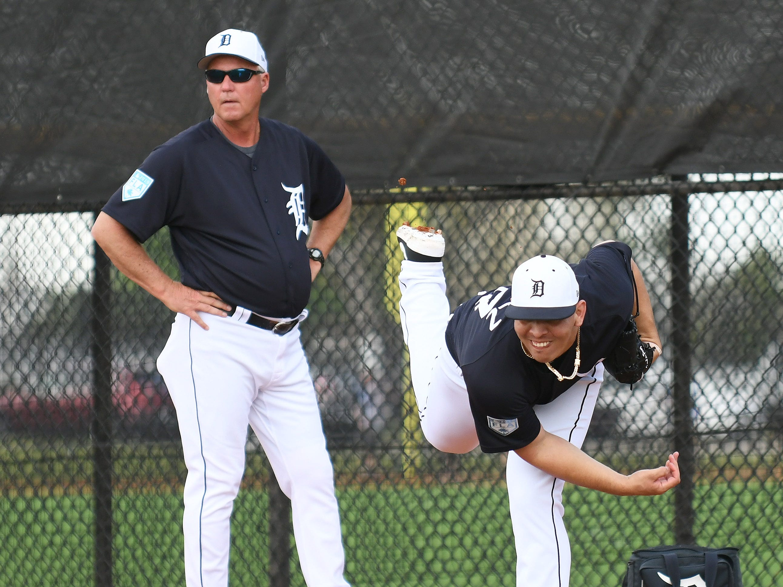 Tigers pitching coach Rick Anderson, left, watches pitcher Franklin Perez work in the bullpen.