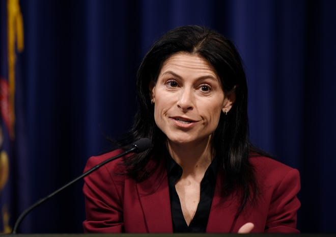 Attorney General Dana Nessel answers questions from reporters during a press conference Thursday morning in Lansing.