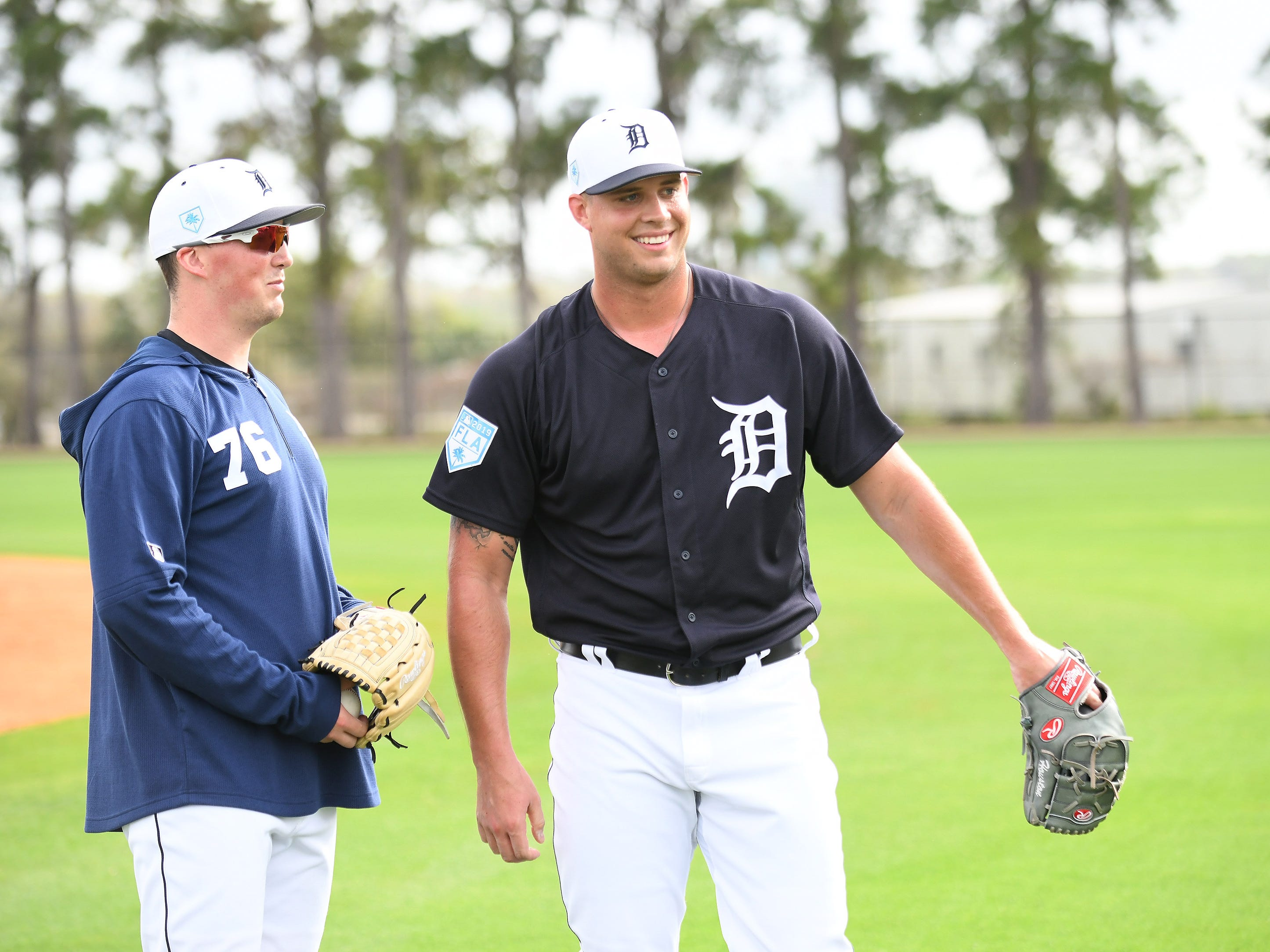 From left, Tigers pitching prospects in big league camp Kyle Funkhouser and Zac Houston, right, talk after warm-ups.