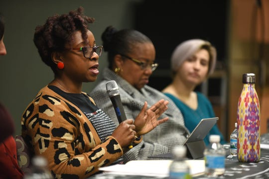 Tamara Butler of the Michigan State University Department of English, left, discusses sex assault with Wayne County Prosecutor Kym Worthy and Amanda Thomashow at 'Resisting Sexual Violence through a Racial Justice Lens: Towards Inclusive Transformation' on Wednesday, Feb. 20, 2018 in Detroit. Max Ortiz, The Detroit News