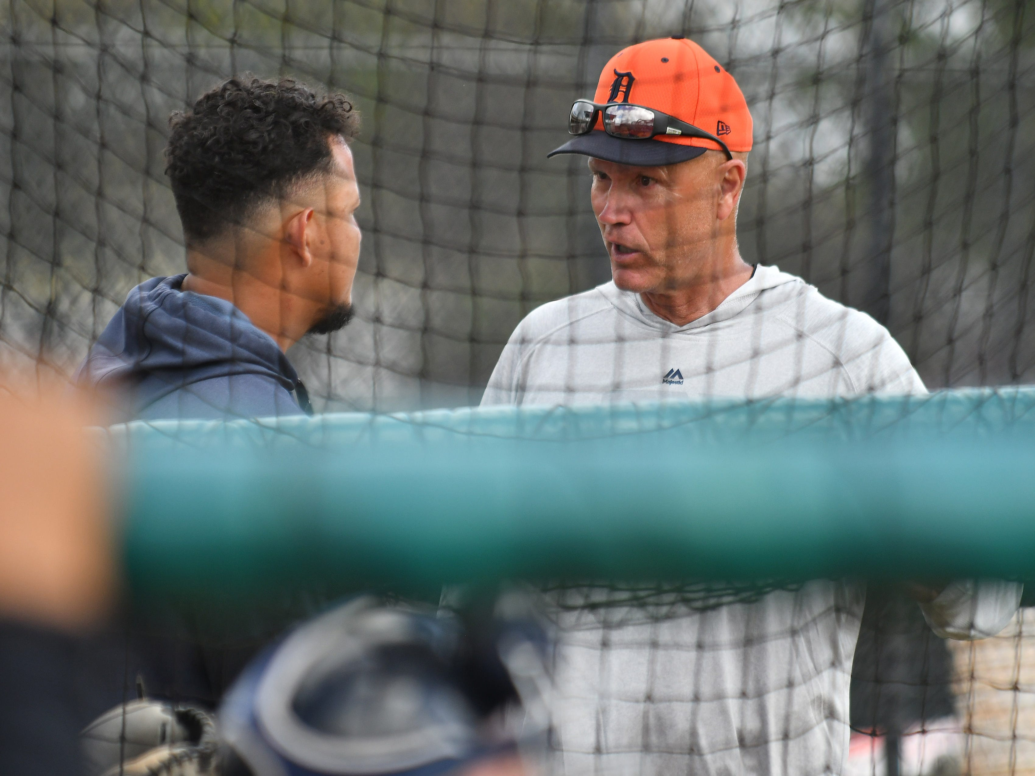 Tigers bench coach Steve Liddle talks with Miguel Cabrera during batting practice.