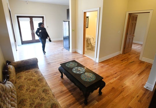 Ashlee Cunningham of Capital Impact tours a 2nd floor apartment of the historic Scott Mansion.