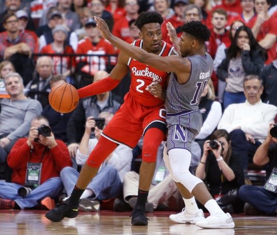 Ohio State's Andre Wesson posts up against Northwestern's Anthony Gaines during the first half.