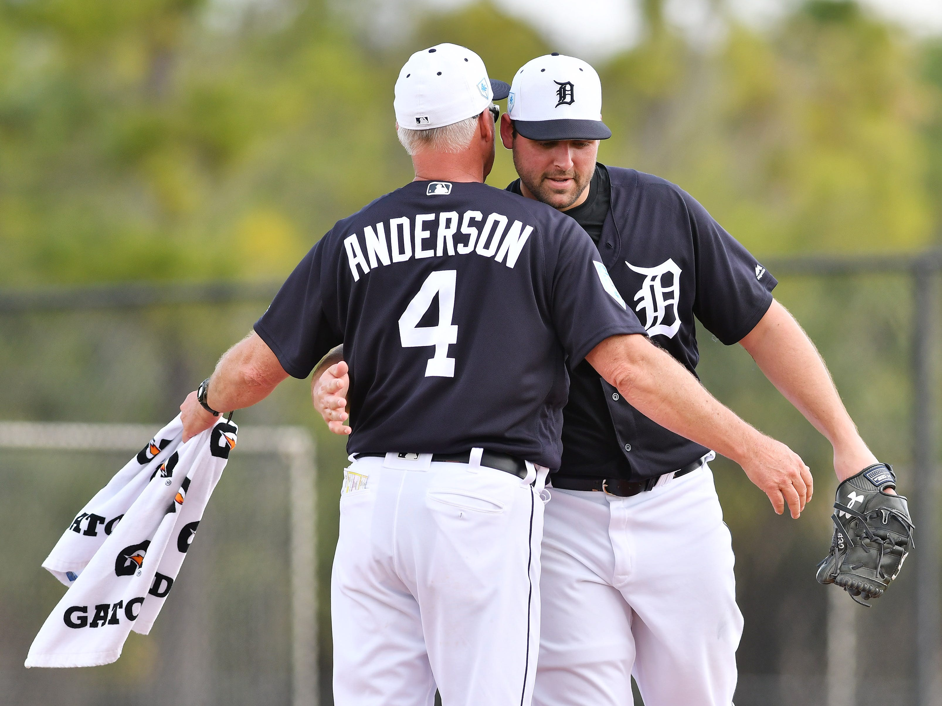 Tigers pitching coach Rick Anderson and pitcher Michael Fulmer meet after Fulmer's first live batting session.