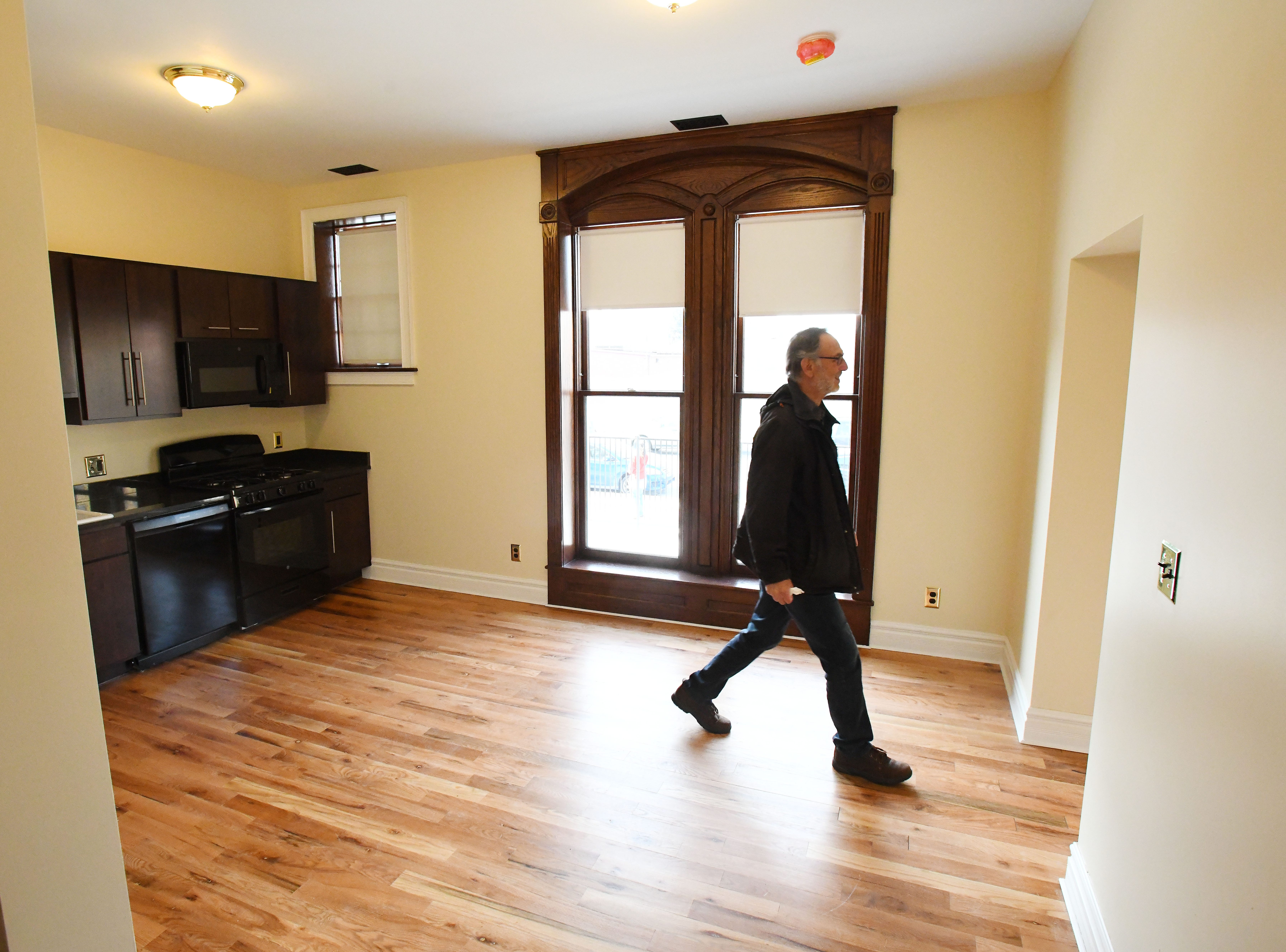 Francis Shor wonders through a 1st floor apartment at the historic Scott Mansion which has been renovated into market-rate rental apartments in the Cass Corridor.