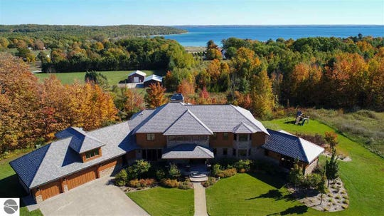 A 12,374-square-foot home sits on more than 48 acres of pastures and vineyards north of Traverse City.