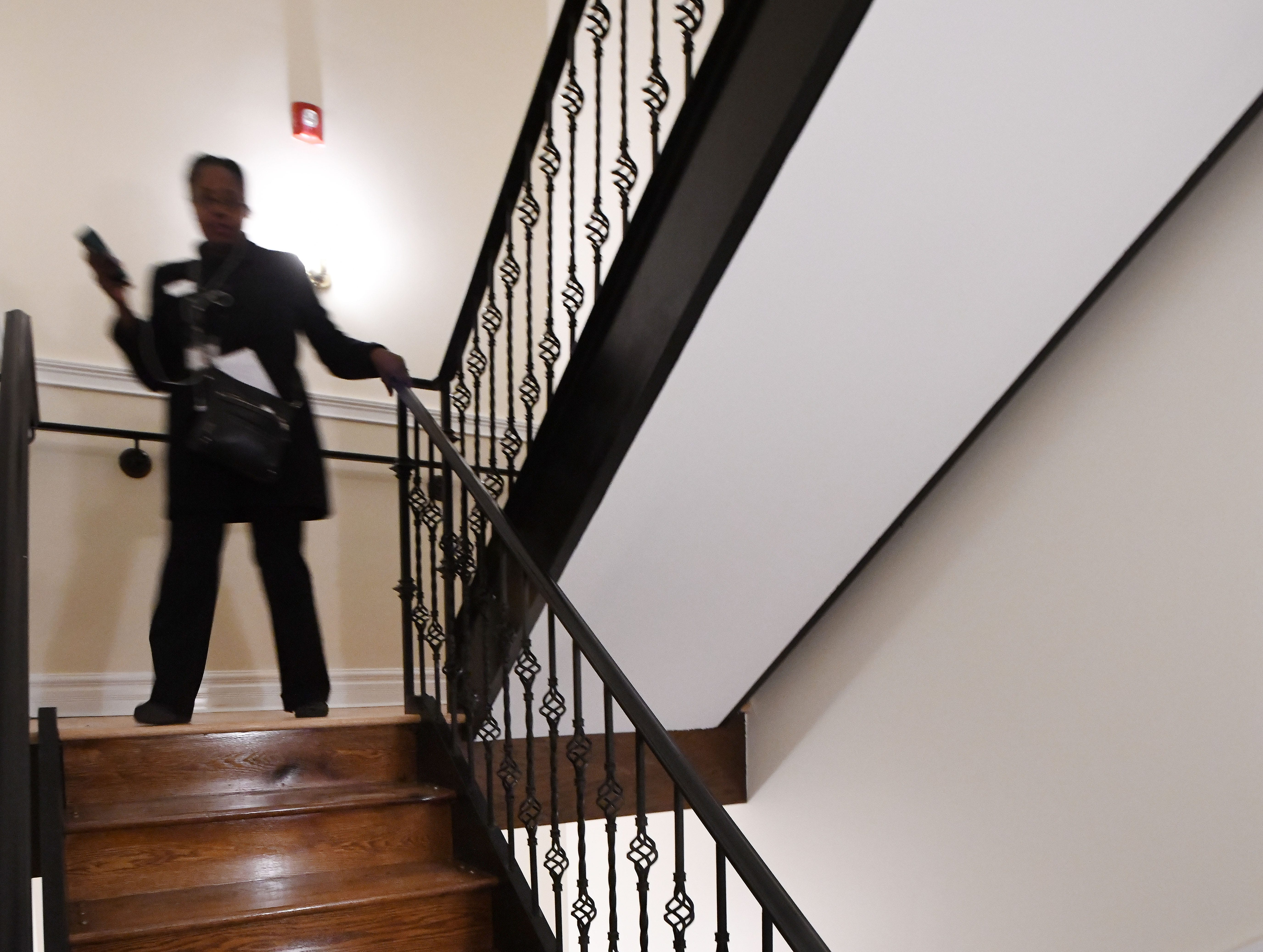 Stairway leading down to the first floor of the historic Scott Mansion.