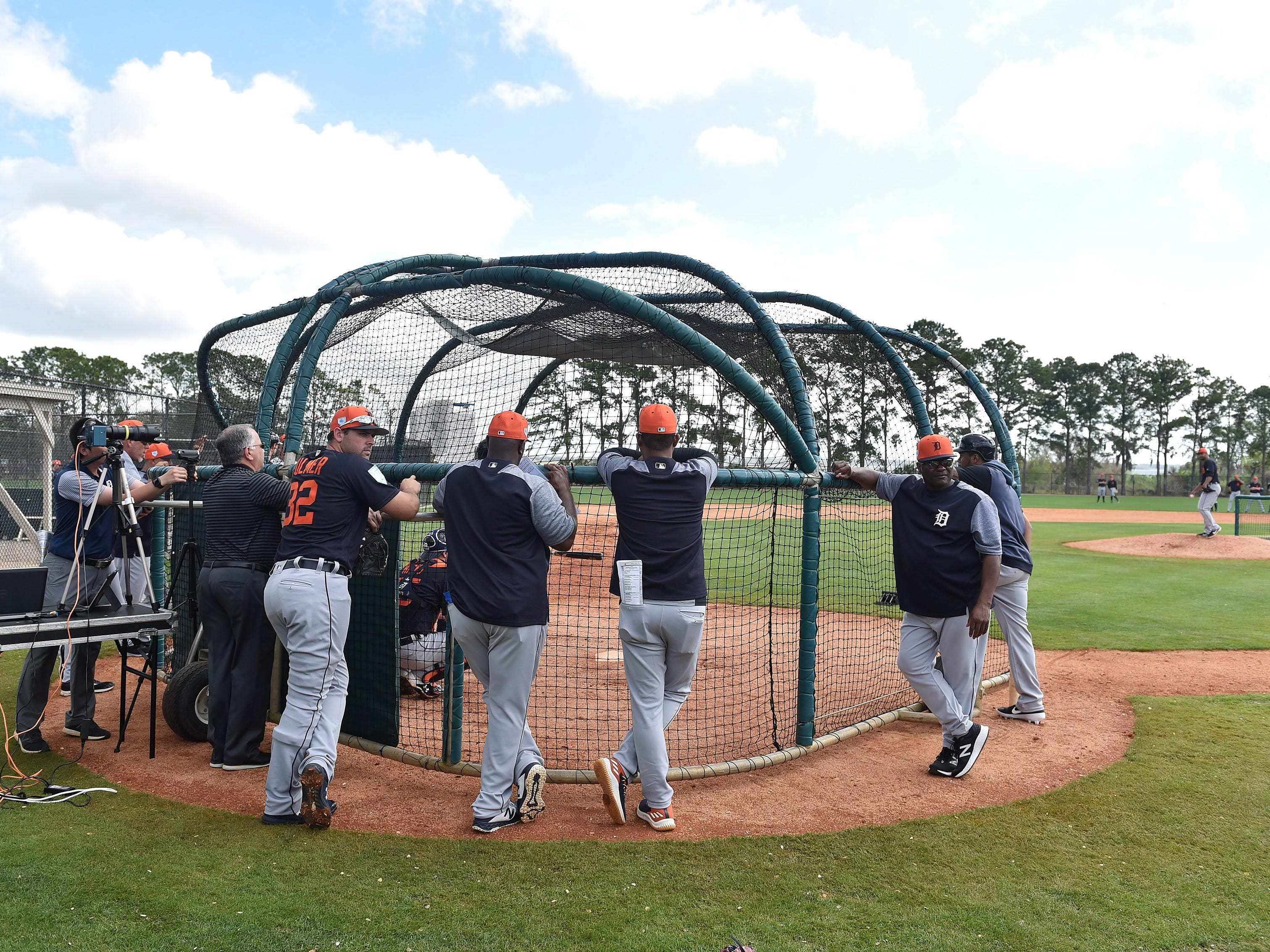 Tigers pitcher Michael Fulmer, left, and hitting coach Lloyd McClendon, right, turn to talk with someone during a break in live batting practice.