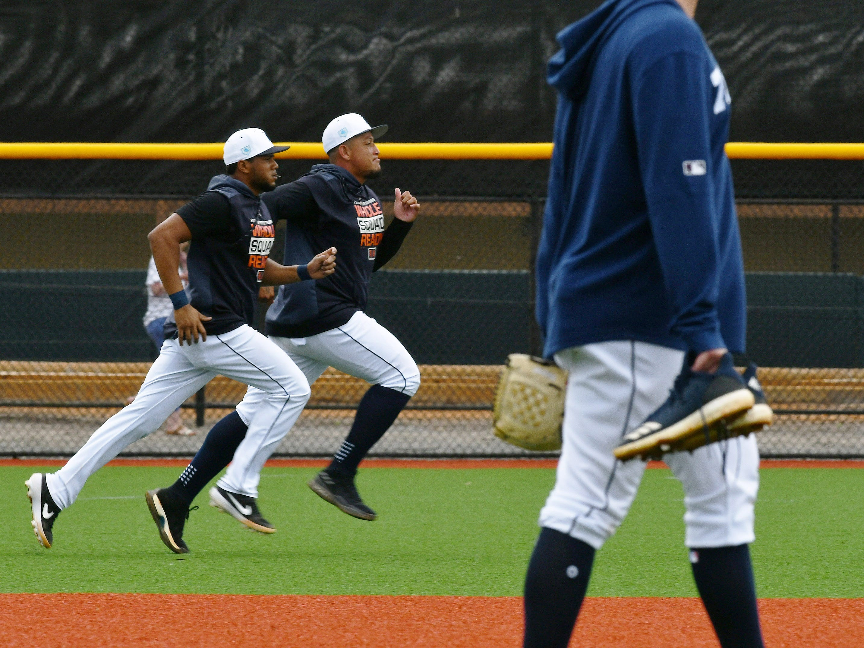 From left, Tigers' Jeimer Candelario and Miguel Cabrera run sprints at the end  of the Tigers workout.