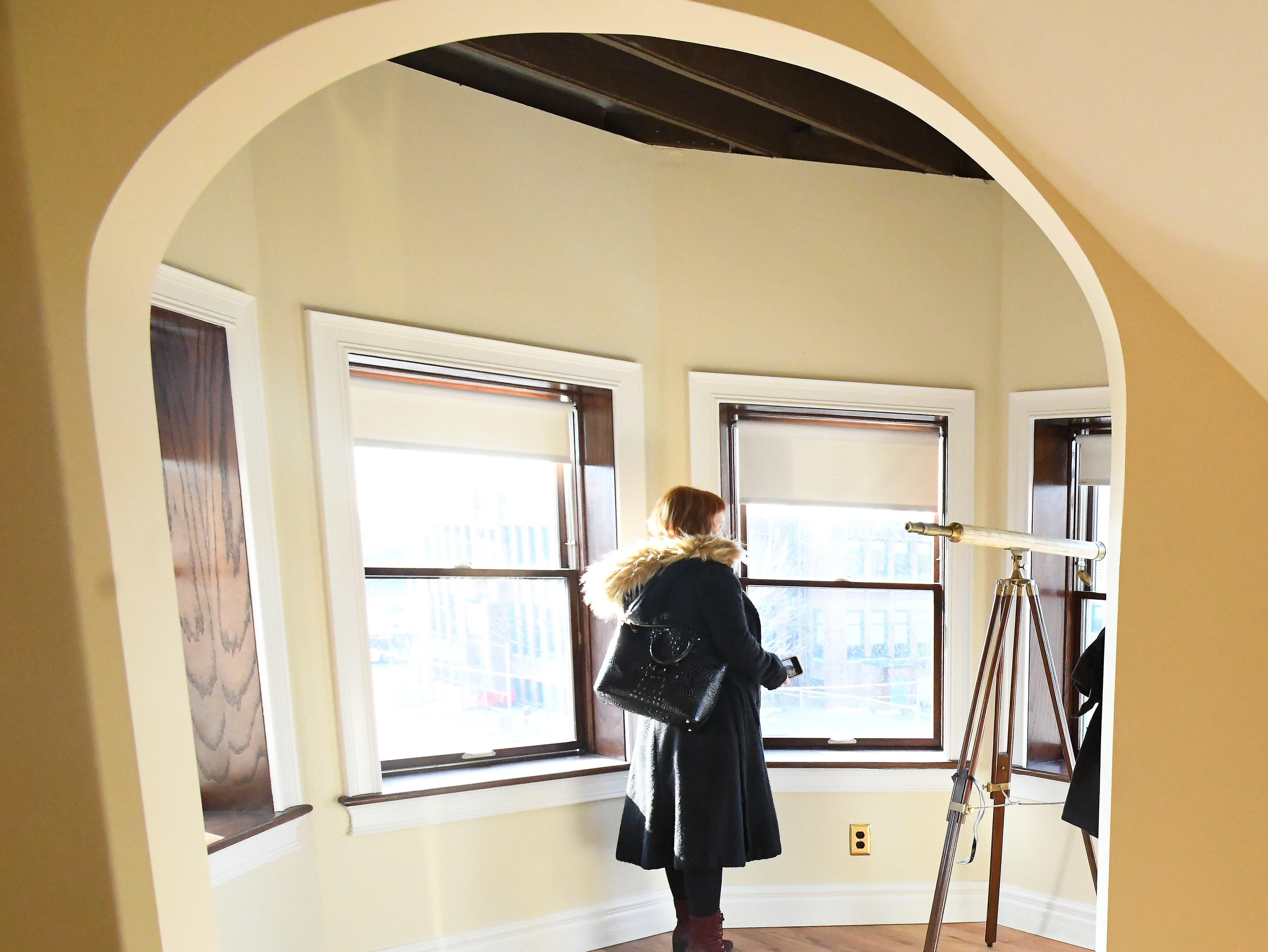 Guests tour a 3rd floor apartment at the historic Scott Mansion .