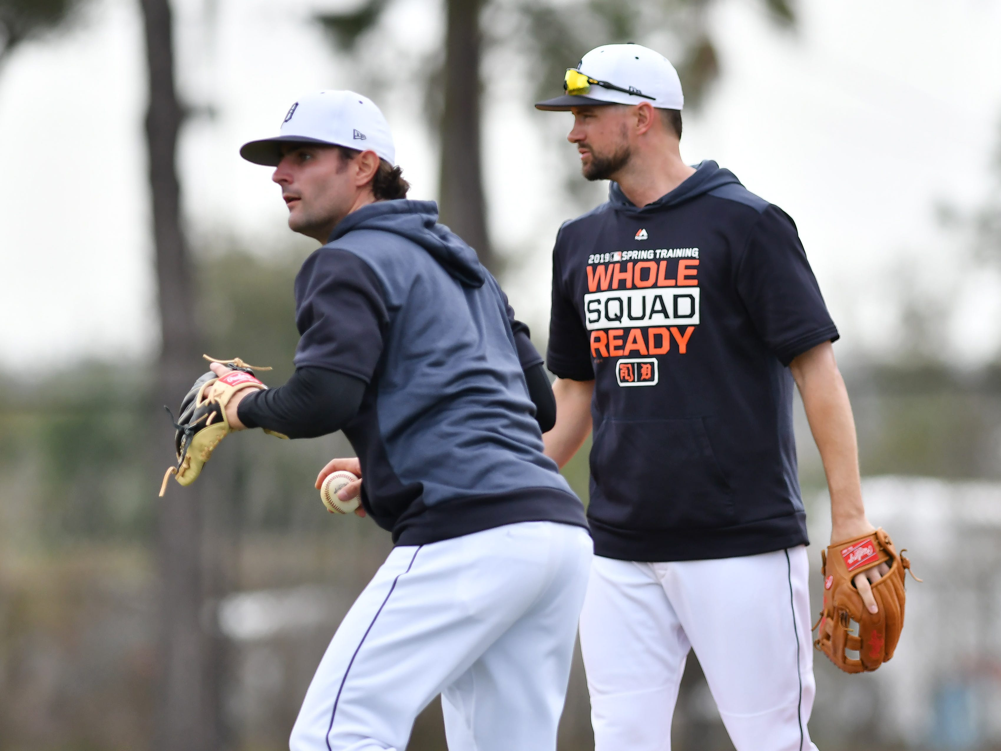 Non-roster invitee Pete Kozma fields a grounder in front of shortstop Jordy Mercer.
