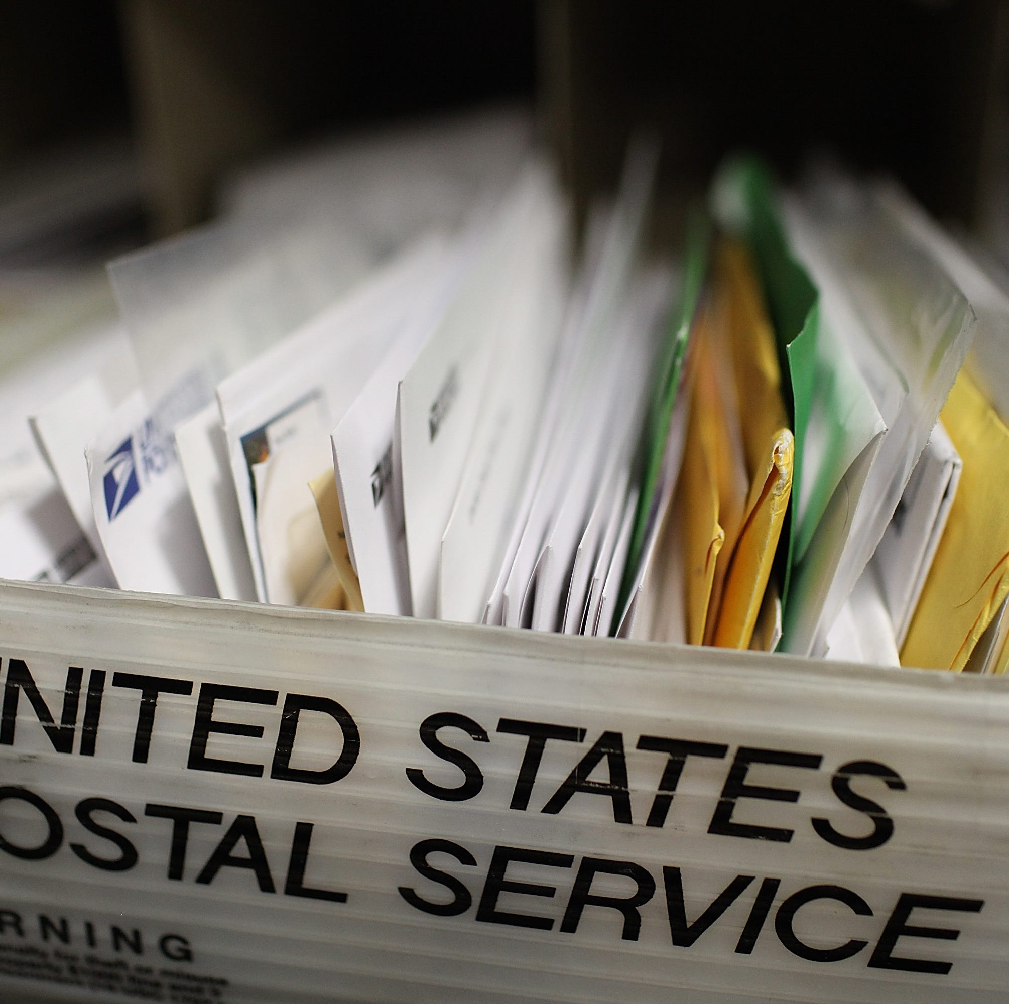 Macomb postal worker faces charges after feds find 15K pieces of mail