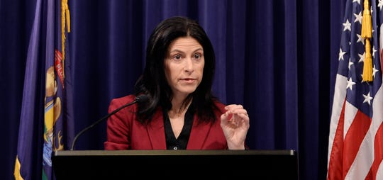 Attorney General Dana Nessel answers questions from reporters during a press conference Feb. 21 in Lansing.