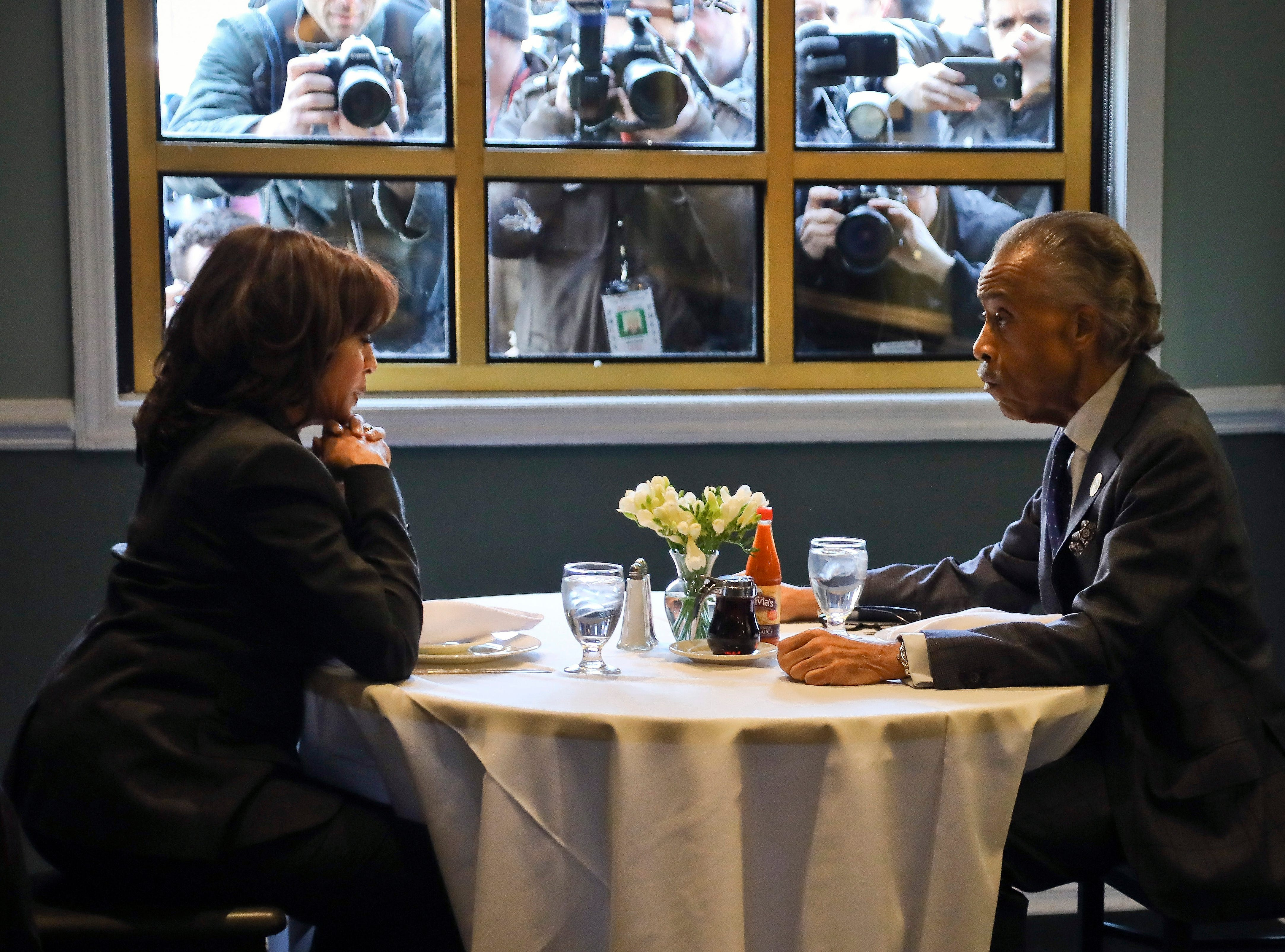 Democratic presidential candidate Sen. Kamala Harris, D-Calif., left, lunches with civil rights leader Rev. Al Sharpton, president of the National Action Network, at Sylvia's Restaurant in the Harlem neighborhood of New York, Thursday, Feb. 21, 2019.
